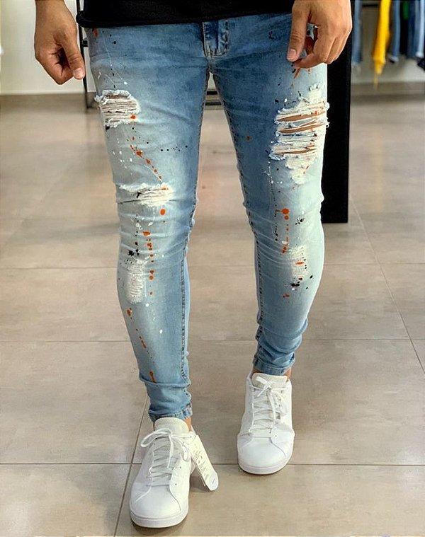Calça Jeans Skinny Destroyed com Respingos Laranja - Creed Jeans