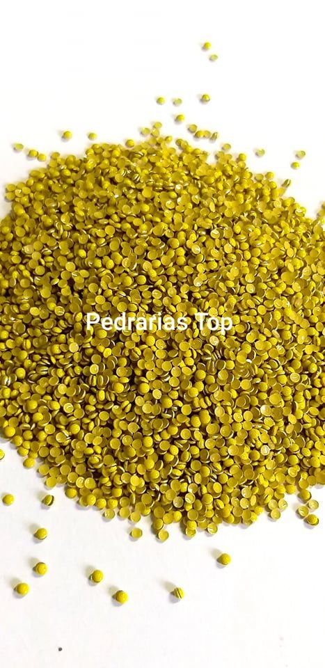 Dome amarelo fluor 2mm - Aprox. 500 pcs