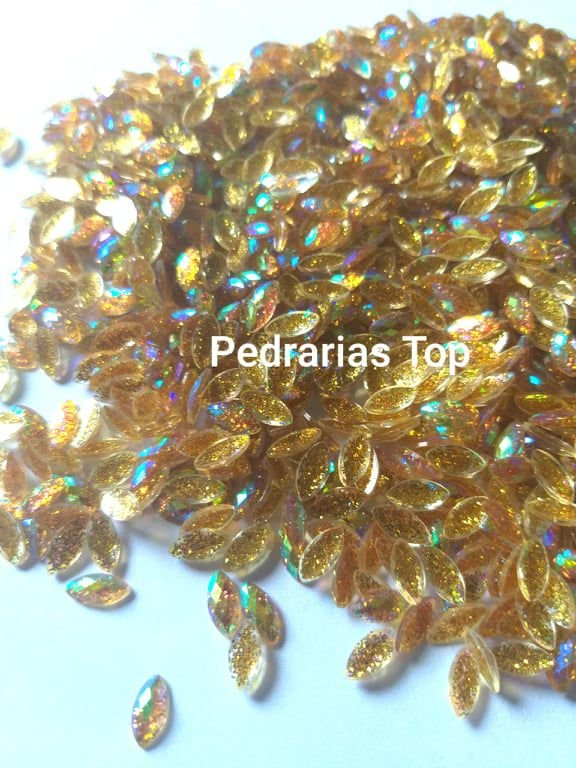 Navete glittler dourado ab aprox. 4x8 c/ 50 pcs