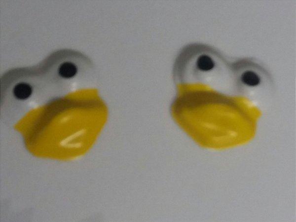 100 unds Cara de pintinho bico amarelo