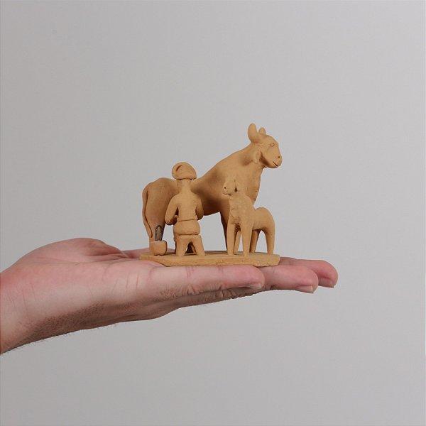 """Miniatura """"Ordenhando a vaca"""""""