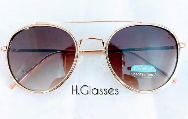 78e89305a Óculos de sol Feminino Dourada/Marrom/epelhado - H.Glasses