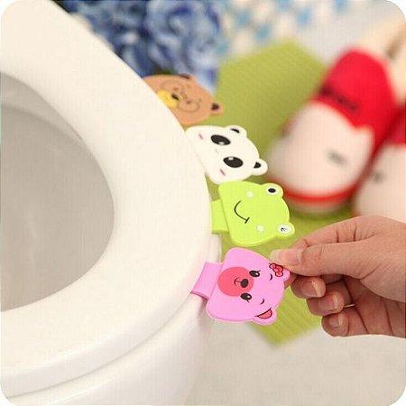 Puxador para tampa de vaso sanitário