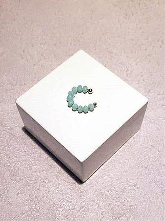 Piercing no cristal verde leitoso