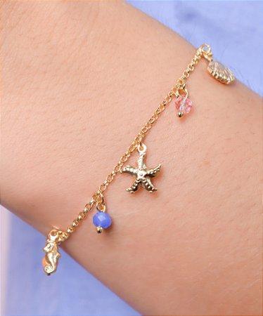 Pulseira de elo português com pingentes de cristal, concha, estrela do mar e cavalo marinho