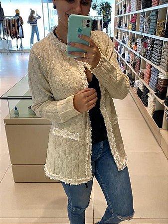 Casaco de tricot longo mousse com aplicação