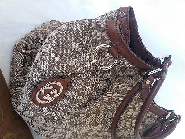 Bolsa Gucci em tecido ,  Original semi nova Impecável