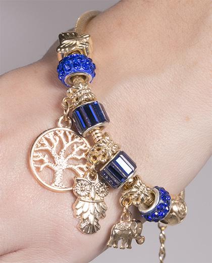 Pulseira de metal dourado com pedra azul Vivian