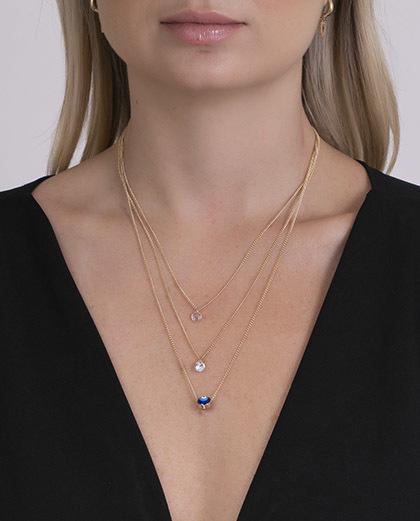 Colar dourado com olho grego e pedra cristal lila