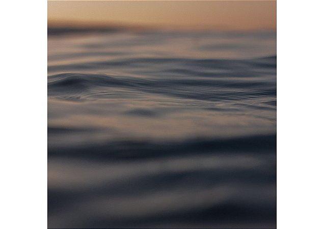 Textura do mar ao nascer do sol