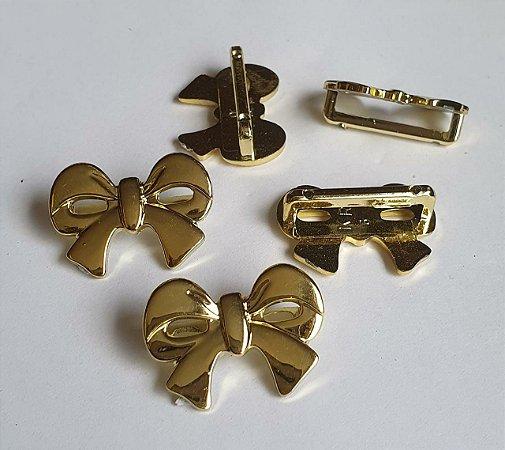 Passante  ABS Laço fita dourado - Tamanho: 26mm X 20mm - Embalagem com 2 unidades