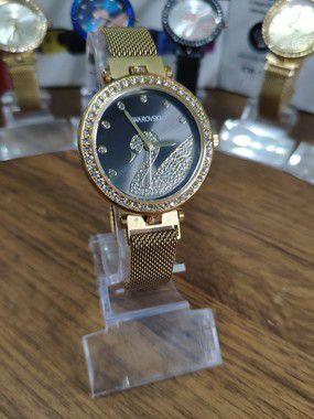 Relógio feminino Swarovski - Dourado e Preto