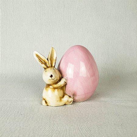 Coelho de cerâmica segurando ovo - Rosa 10cm