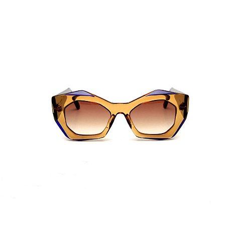 Óculos de sol Gustavo Eyewear G108 2. Cor: âmbar e azul. Haste azul. Lentes marrom.
