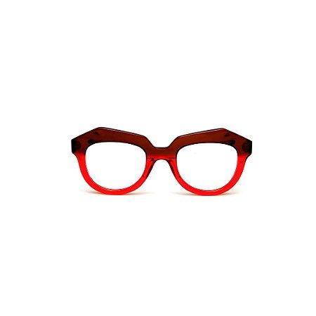 Armação para óculos de Grau Gustavo Eyewear G37 106. Cor: Vermelho e marrom translúcido. Haste marrom.