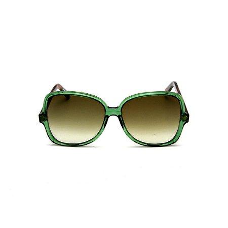 Óculos de Sol Gustavo Eyewear G110 4. Cor: Verde translúcido. Haste animal print. Lentes verde.