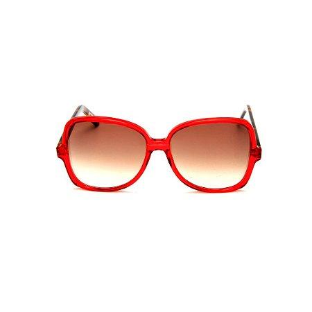 Óculos de Sol Gustavo Eyewear G110 9. Cor: Vermelho translúcido. Haste animal print. Lentes marrom.