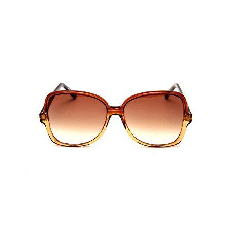 Óculos de Sol Gustavo Eyewear G110 10. Cor: caramelo e âmbar translúcido. Haste animal print. Lentes marrom.
