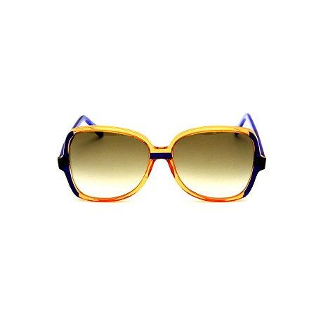 Óculos de Sol Gustavo Eyewear G110 12. Cor: Caramelo e azul translúcido. Haste azul. Lentes marrom.
