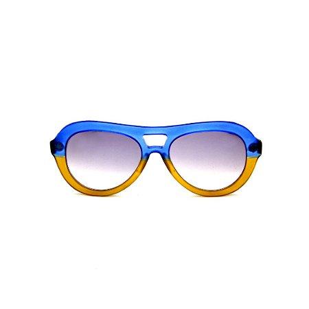 Óculos de Sol Gustavo Eyewear G113 2. Cor: Azul e caramelo translúcido. Haste animal print. Lentes cinza.