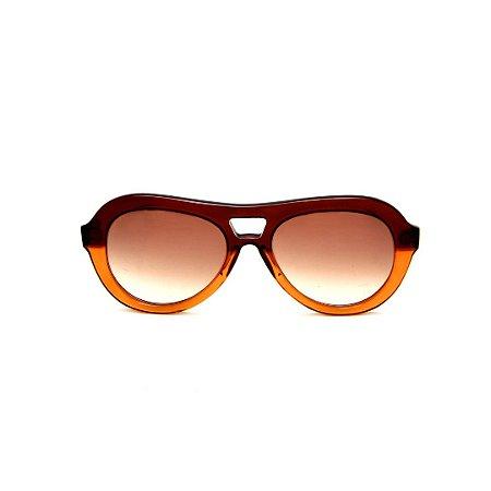 Óculos de Sol Gustavo Eyewear G113 3. Cor: Marrom e âmbar translúcido. Haste animal print. Lentes marrom.