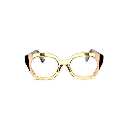 Armação para óculos de Grau Gustavo Eyewear G70 25. Cor: Âmbar com listras nude e preto. Haste preta.