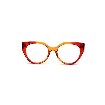 Armação para óculos de Grau Gustavo Eyewear G117 2. Cor: Vermelho e caramelo translúcido. Haste vermelha.