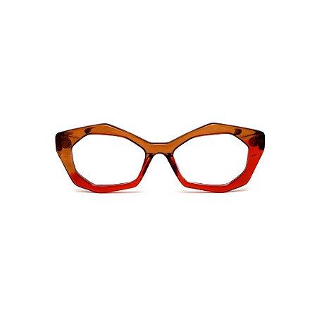 Armação para óculos de Grau Gustavo Eyewear G53 14. Cor: Marrom e vermelho translúcido. Haste animal print.