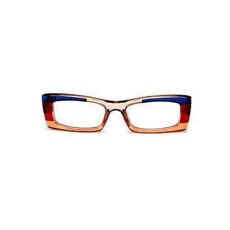 Armação para óculos de Grau Gustavo Eyewear G35 21. Cor: Laranja, azul, âmbar e vermelho translúcido. Haste vermelha.