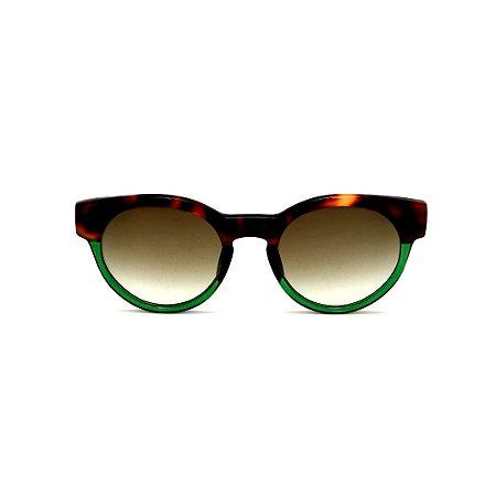 Óculos de Sol Gustavo Eyewear G63 1. Cor: Animal print e verde translúcido. Haste animal print. Lentes verdes.