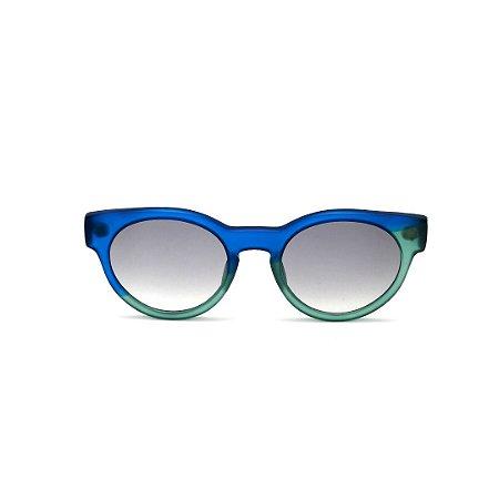 Óculos de Sol Gustavo Eyewear G63 5. Cor: Azul  e acqua translúcido. Haste azul. Lentes cinza.