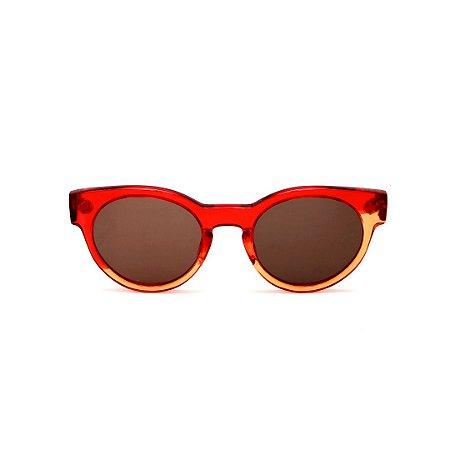 Óculos de Sol Gustavo Eyewear G63 7. Cor: Vermelho e âmbar translúcido. Haste vermelha. Lentes marrom.
