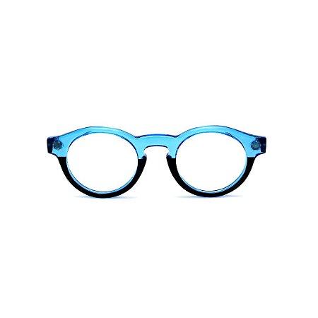 Armação para óculos de Grau Gustavo Eyewear G29 18. Cor: Azul translúcido e preto. Haste preta.