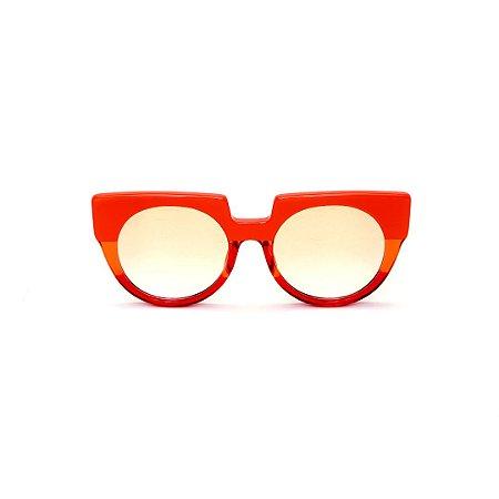 Óculos de Sol Gustavo Eyewear G135 2. Cor: Laranja opaco, laranja e vermelho translúcido. Haste animal print. Lentes âmbar.