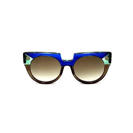 Óculos de Sol Gustavo Eyewear G135 4. Cor: Azul, acqua e fumê translúcido. Haste verde. Lentes cinza.