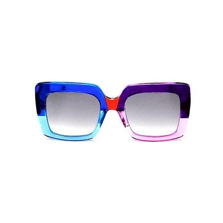 Óculos de Sol Gustavo Eyewear G59 9. Cor: Azul, acqua, vermelho, lilás e violeta translúcido. Haste preta. Lentes cinza.