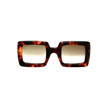 Óculos de Sol Gustavo Eyewear G01 1. Cor: Animal print. Haste animal print. Lentes marrom.