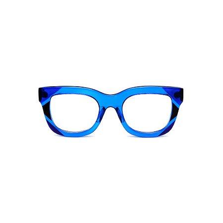 Armação para óculos de Grau Gustavo Eyewear G57 6. Cor: Azul translúcido e preto. Haste preta.