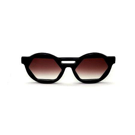 Óculos de Sol Gustavo Eyewear G134 10. Cor: Preto. Haste animal print. Lentes marrom.