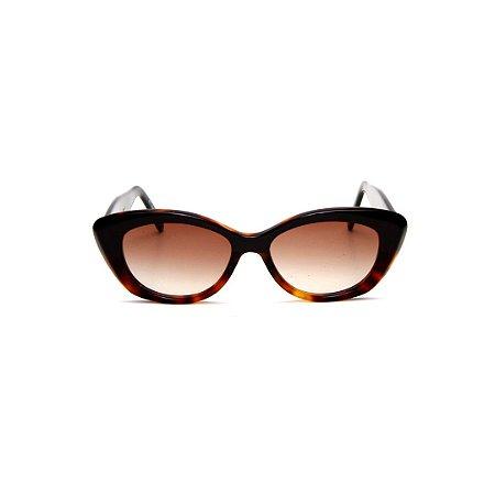 Óculos de Sol Gustavo Eyewear G103 1. Cor: Animal print e preto. Haste animal print. Lentes marrom.