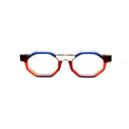 Armação para óculos de Grau Gustavo Eyewear G136 3. Cor: Vermelho, laranja âmbar, violeta e azul translúcido. Haste marrom.