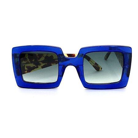 Óculos de Sol Gustavo Eyewear G1 100. Cor: Azul translúcido. Haste animal print.