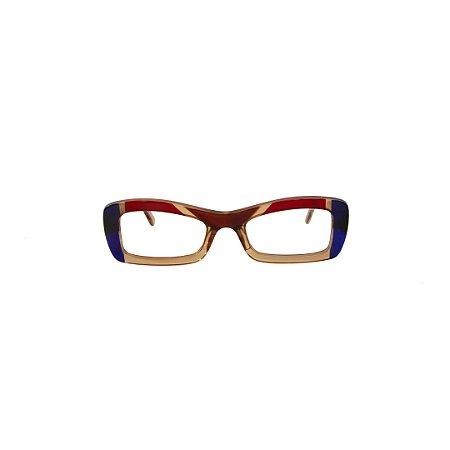 Armação para óculos de Grau Gustavo Eyewear G34 18. Cor: Âmbar, azul e vermelho translúcidos. Haste âmbar translúcido.