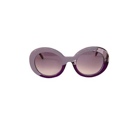 Óculos de Sol Gustavo Eyewear G61 4. Cor: Fumê, lilás e fumê translúcidos. Haste animal print. Lentes cinza.
