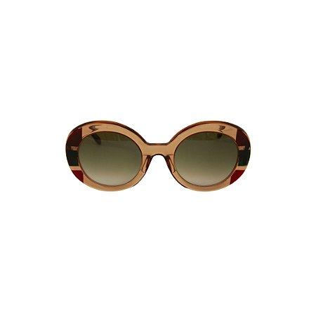 Óculos de Sol Gustavo Eyewear G61 7 . Cor: Âmbar, vermelho e preto translúcidos. Haste animal print. Lentes cinza