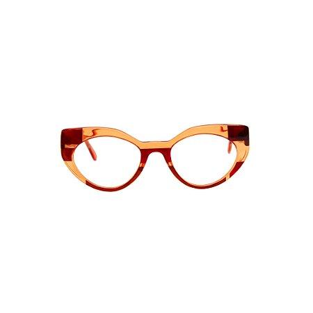 Armação para óculos de Grau Gustavo Eyewear G93 5. Cor: Âmbar e vermelho translúcido. Haste vermelha translúcido.