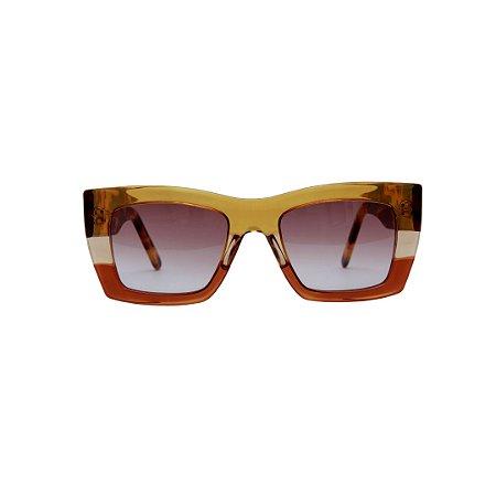 Óculos de sol Gustavo Eyewear G79 3. Cor: Guaraná, âmbar e marrom translúcido. Haste animal print. Lentes marrom.