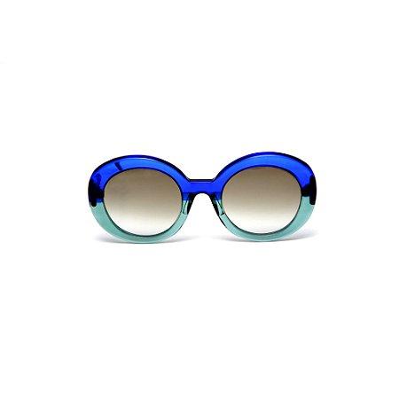 Óculos de sol Gustavo Eyewear G61 18. Cor: Azul e acqua translúcidos. Haste azul. Lentes cinza.