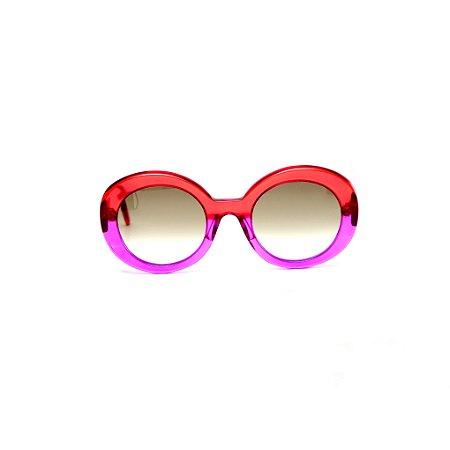 Óculos de sol Gustavo Eyewear G61 21. Cor: Vermelho e violeta translúcidos. Haste vermelha.