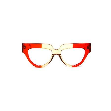 Armação para óculos de Grau Gustavo Eyewear G40 10. Cor: Vermelho translúcido e âmbar. Haste vermelha.